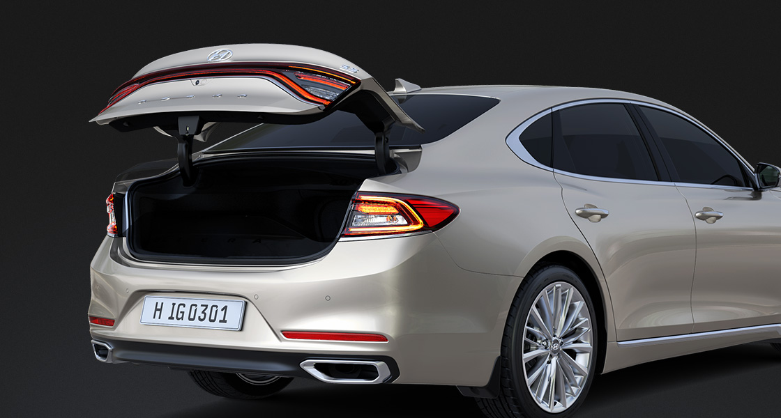 Rear view of luminous beige Azera with trunk door opened