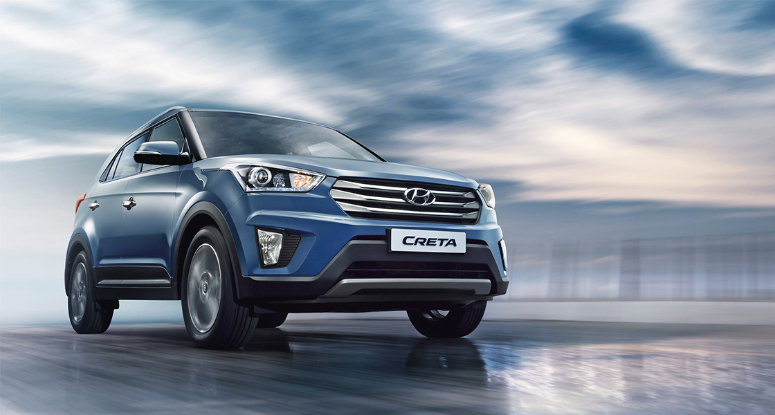 Side front view of navy Creta driving on a cloudy day