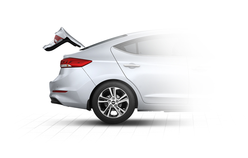 Side view of silver Elantra with trunk door opened