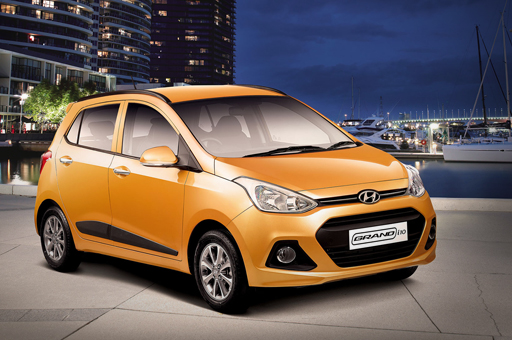 Side front view of tangerine orange Grand i10